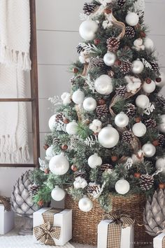 Burlap ribbon from top to bottom, large white balls. pine cones, rusty metal bells, and little pieces of cotton wood.
