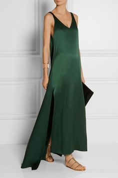 Stunning. This minimalist emerald satin de soie sleeveless maxi dress looks so chic and comfortable. Classic yet so stylish by Rosetta Getty.