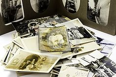 A display of Vintage Family Photographs with an Album in the background