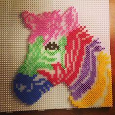 Rainbow zebra hama beads by queengref - Pattern: http://www.pinterest.com/pin/374291419004635363/
