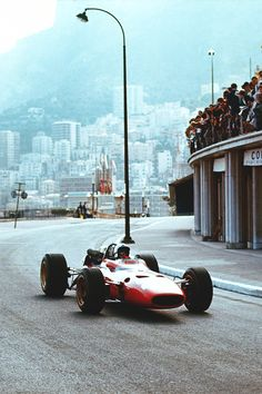reblog week meets Ferrari Friday … what we miss … natural grandstandsChris Amon, Ferrari 312/67, 1967 Monaco Grand PrixAmon on his way to a podium finish with 3rd place, coming all the way from 14th on the grid, albeit 2 laps down on race winner Denny Hulme