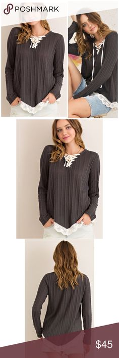 Lace Up Ribbed Sweater Solid cut and sew ribbed sweater top featuring V-silhouette neckline with lace-up detail. Edge lace detail on V-shape hemline. Non-sheer. Knit. Color Grey  65%POLYESTER 35%COTTON Threads & Trends Sweaters
