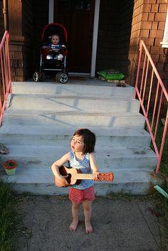 A kid with ukulele. Cute!