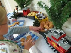 Polar Express Party- train cars filled with finger foods like pigs in a blanket, brownie balls (coal) and crackers. Cheese and olive kabobs along with fruit kabobs filled glass vases of sugar to resemble snow.