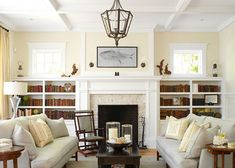 Living Room - book shelves with windows above, centered fireplace, mantel.  A hearth might be nice...