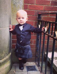 Baby Cooper wearing a Highland Granite kilt outfit.