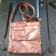 Brown leather purse Barely used in excellent condition from smokefree home. Real brown leatherno brand name. Bought at Super Shoes store. Adjustable strap for crossbody or shoulder. Bags
