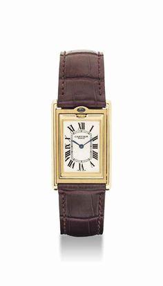 Cartier. A fine and unusual 18K gold and sapphire-set rectangular reversible wristwatch. circa 1997. #watch