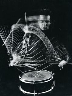 Drummer Gene Krupa Playing Drum at Gjon Mili's Studio Premium Photographic Print by Gjon Mili at AllPosters.com