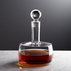 With its square bowl, columnar neck and round bubble stopper, the Corbin whiskey decanter puts a modern edge to aerating fine wines or storing spirits. Handcrafted of sparkling, lead-free crystalline glass, each vessel is created by a team of skilled glassmakers.