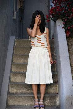 nice graphic tank on midi white skirt, topped off with a stripey pair of heels