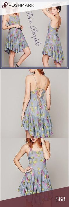 Free People Circle of Flowers Slip Dress Size : medium / EUC : the photos on the mannequin are the actual dress. The last photo shows how the back tie can be used to adjust the fit of this dress. I'm a size XS/Small in almost all Free People dressed but this fits perfectly when the back is tied tight. Free People Dresses Asymmetrical