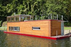 Have you ever daydreamed of selling all of your worldly possessions and buying a boat or had that romanticized notion of living on a houseboat with the water gently rocking you to sleep? After seeing Thesayboat houseboat, I want to make that dream a reality. Designed and owned by Marek Ridky of Flowhouse in the Czech Republic, the houseboat's design was created as a home with views of the stars. Floating Architecture, Amazing Architecture, Little Houses, Floating Homes, Houseboats, Container Store, Pontoons, Building Plans, Boat Building
