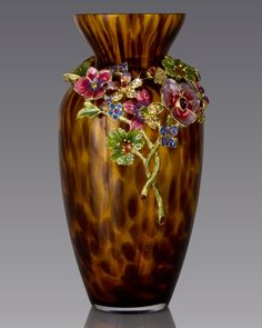 """Handcrafted vase. Mouth-blown glass with cast-metal collar. Hand enameled and hand set with Swarovski crystals. 4""""Dia. x 8""""T. Imported."""