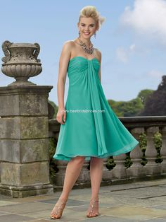 Jordan 144.   Chiffon knee length dress with a shirred empire strapless bodice and draped skirt. The removable spaghetti straps are included. Available in short, knee and floor lengths.