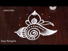 Simple Lotus shanku kolam for festivals Rangoli Designs Peacock, Indian Rangoli Designs, Simple Rangoli Designs Images, Rangoli Designs Latest, Rangoli Border Designs, Rangoli Designs With Dots, Rangoli With Dots, Beautiful Rangoli Designs, Free Hand Rangoli Design