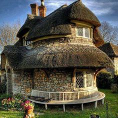 A rubble stone lime mortar thatched cottage in Blaise Hamlet near Bristol, UK