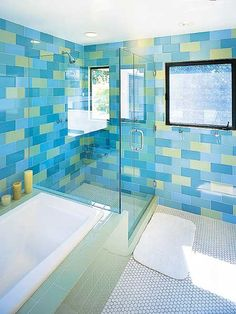 the multi-color subway tiles are a refreshing choice. might keep it from looking dated and blah.