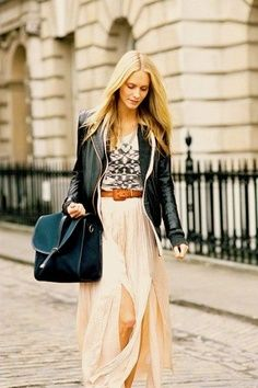 Country wine street fashion. Maxi skirt in flow with leather jacket in style.