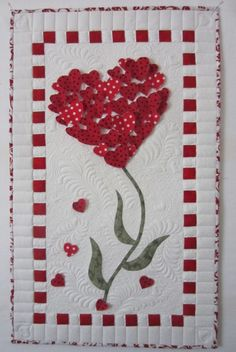 This is a gorgeous Red and White with a touch of green Heart Flower wall hanging. It could be perfect for Valentine's Day or for a child's whimsical room. The quilt work and the applique work are done skillfully....just beautiful.  20130228-143148.jpg