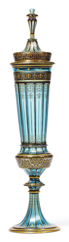 LOBMEYR ___jewelled turquoise glass large cup & cover circa 1880 of elongated faceted form, painted and gilt with stylized foliate- and strapwork, white enamel JLL monogram mark. height overall 21 in Antique Art, Vintage Antiques, Carafe, Antique Glassware, Bohemian Art, Turquoise Glass, Bernard Shaw, White Enamel, Bottle Crafts