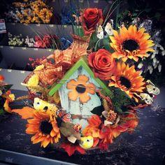 Silk birdhouse floral arrangement Birdhouse Designs, Bird Houses, Floral Arrangements, Florals, Floral Design, Thanksgiving, Silk, Outdoor Decor, Artwork