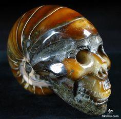 Carved ammonite skull