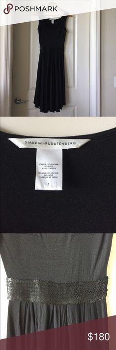 Black sleeveless dress Diane von Furstenberg black sleeveless dress with a black sequence detail around the waist line. Dress length is to the knee. Size 4. In great condition!!! Diane Von Furstenberg Dresses