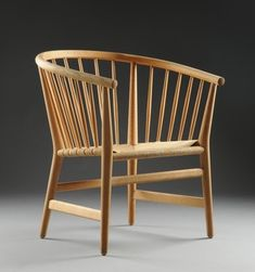 H. J. Wegner, armchair model PP-112, ash, woven papercord seat. Produced by PP Møbler, labelled accordingly underneath the frame. See also lot no. 1624851.