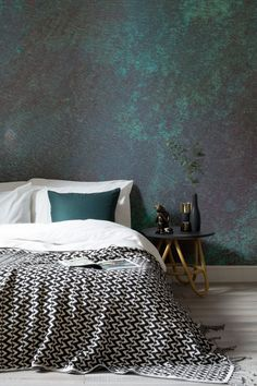 Capture the beauty of imperfections with this verdigris wallpaper. Showcasing the natural degradation of rusted copper, there's a wonderful mixture of sea greens and brassy undertones. Pair with metallic accessories for an overall luxury look.