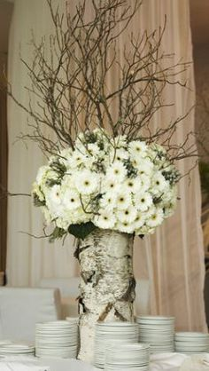 Something similar to this for a feature? even for the ceremony arrangements- not gerbs but other flowers...