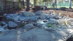 A flowing river with shingle pit in background at kindergarten.