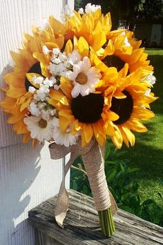 Example of a bouquet that probably has about 11 sunflower. Also has classic daisies and some babies breath but they seem to get lost in this bouquet. So I want to do more babies breath and chamomile, a few less sunflowers. Spring Wedding Flowers, Fall Wedding, Wedding Bouquets, Rustic Wedding, Dream Wedding, Trendy Wedding, Wedding Bridesmaids, Wedding Yellow, Wedding Country
