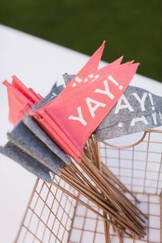 These felt flags are hand cut and silk screened. Great for your ceremony or send off! 20 grey 20 coral