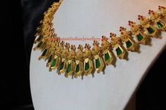 Nagapadam is a beautiful and traditional Kerala jewellery design representing the open hood of naga. insert comes in green, red, blue or black bhima Kerala Jewellery, Indian Jewellery Design, Temple Jewellery, Indian Jewelry, Jewellery Designs, Jewellery Box, Gold Wedding Jewelry, Bridal Jewelry, Gold Jewelry