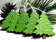 embossed green cardstock with different embossing folders and cut out with Christmas tree punch