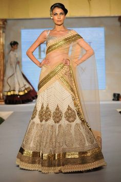 Beige and gold lehnga by Ecru Luxury