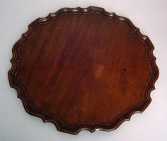 "Pook & Pook.  September 28th & 29th 2007. Lot 422.  Estimated: $800 - $1200. Realized Price: $2340. Chippendale mahogany piecrust tray, late 18th c., 16 1/2"" dia."