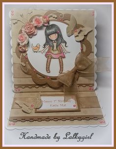 A gorjuss girl card ,using the stamp and papers from the new papermania gorjuss range,