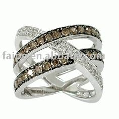 While I don't like Chocolate diamonds this ring design is amazing. I'd prefer saphires to have both of my daughter's birthstones with me.
