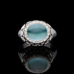 Favero 18Kt White Gold Oval Cabochon Cut 2.92ct Moonstone Ring set with approximately 0.26cts of Round Brilliant Cut Diamonds. The total weight of the ring is 13.57 grams and is a size 5.