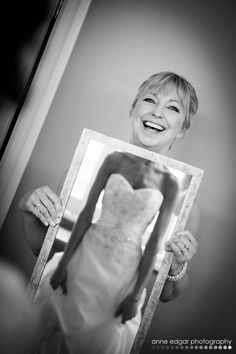 Cute!  Bride's mom holding mirror with daughter's reflection