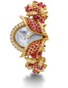 Watch by Piaget - rubies and diamonds set in yellow gold
