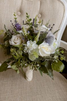 Rustic ivory and lavender wedding bridal bouquet. Made with artificial roses, hydrangea, heather, lavender and simple greenery. This bouquet is available in 3 different sizes, - bridal (10 inch), bridesmaids (7-8inch) and flower girl (5inch). The stems of the bouquet can be bound