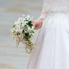 Brides.com: Royal Wedding Photos. The Bouquet. Kate carried a small, shield-shaped wired bouquet of myrtle, lily-of-the-valley, Sweet William, and hyacinth. The bouquet was designed by Shane Connolly.