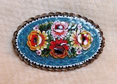 Antique Rose Mosaic Italian Millefiori Glass Flower Brooch Pin is simply magnificent! There are four roses with green leaf accents against a backdrop of turquoise blue.  Made in Italy.
