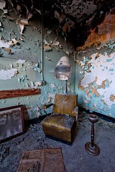 A decaying room and beauty shop chair at a former psychiatric hospital. Photo by Scott Haefner