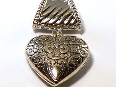 Bling Bling, Silver Tone Heart Scarf Pendant Hail Mary Gifts, http://www.amazon.com/dp/B0096SEV6Q/ref=cm_sw_r_pi_dp_dt6Tqb1MP6995
