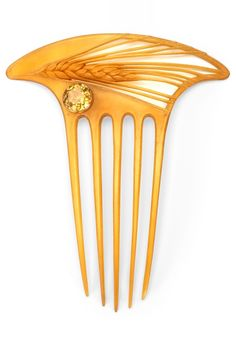 Lucien Gaillard - An Art Nouveau 'Wheat' hair comb, circa 1900. Carved horn set with a faceted crystal. Signed in intaglio on comb, L.Gaillard.