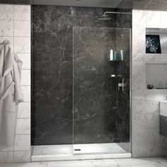 Ideally, we'd have something like this cut and installed by Wheelhouse's glass contact. The shower head pictured also seems like a good choice for a smaller water containment area. $300 on Overstock. Linea Frameless Shower Door 34 in. x 72 in. Open Entry Design